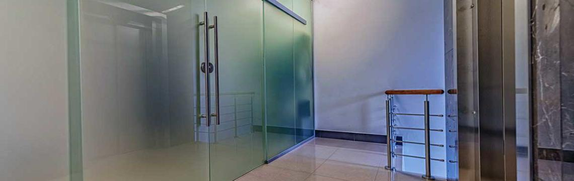commercial glass company installation of large sliding glass doors
